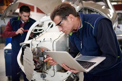 Aircraft mechanics in the hangar